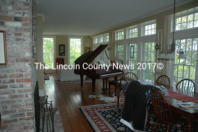 A grand piano sits in the great room of the Hall/Ross home overlooking the Sheepscot River on Westport Island. (Joe Gelarden photo)