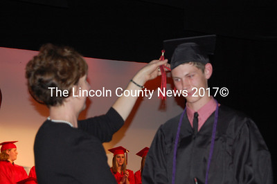 Wiscaasset Principal Susan Poppish turns the tassel of exchange student Andreas Kuhnel from Denmark. (Greg Foster photo)