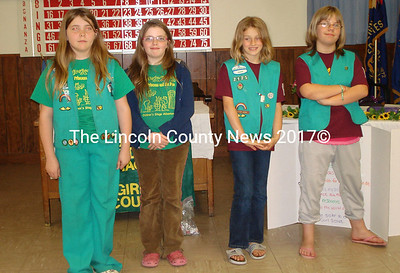 Girl Scouts are (left to right) Caroline Dustin, Harley Dustin, Sarah Harvey and Shelby Wile received the Bronze award.  Missing from the photo: Breanna McKay and Jenny McKay.
