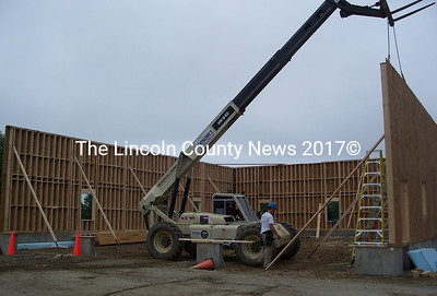 Catalano's Construction Co. workers erect one of the walls of the Alna firehouse addition this week. (Greg Foster photo)