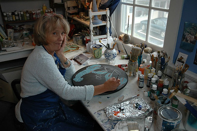 Artist Suzanne Norton paints unique designs on furniture in her second floor studio/shop in the Weatherbird Shops in Damariscotta. Norton's work is seen in homes and businesses throughout Lincoln County. (Joe Gelarden photo)