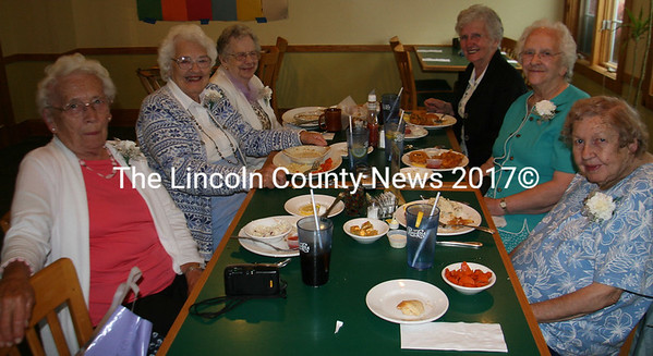 "Waldoboro High School Class of 1939 met at the Country Farms restaurant in Whitefield on Sunday to celebrate their 70th reunion. There are six people remaining in their class who share their good company over plates of food and fond memories. Absent from the photo is Beatrice Bagley Bragg of Augusta. On left is Jeanne Ifill Conley of Bremen, Eleanor Winchenbach Smith of W. Waldoboro and Marjorie Orff Freeman of Waldoboro. On right is Dorothy Smith Maxcy of Jefferson and Salutitorian Gertrude Newbert Pratt of Nobleboro. Seated on far right is the party's Chauffeur, Myrtle Brady. According to Conley, the original class amounted to 24 or 25 graduates. The party gathered to remember all of their classmates, including George Teague of N.Y. and Warren Carroll of Mass. who recently passed away.  Maxcy worked at the Osram Sylvania filament plant for 25 years after graduation. Pratt taught at the Friendship St. School. She also conducted ministry service at Fieldcrest Manor for 40 years. ""We all started in a one-room schoolhouse,"" Freeman said. (J Maguire photo)"