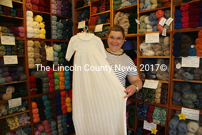 Mary Lou D'Aquila officially opened her shop on upper Main Street in Waldoboro, Eagle's Nest Yarns on June 24. Knitters and yarn crafters can now enjoy a new shop and learning space. D'Aquila displays a Christening dress and bonnet made of knitted lace she will submit to Art for the Animals, which supports the Knox County Animal Shelter. The garment took approximately seven months (or 300 hours) to knit. (J Maguire photo)