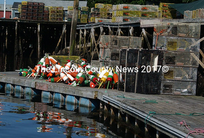 The float at South Bristol Co-op is piled with lobster bouy's that were retrieved after trap lines were cut last week. (Paula Roberts photo)