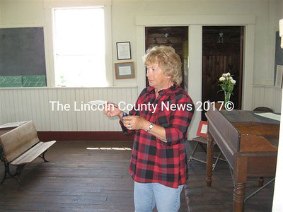Volunteering for the Committee for Alna History on Saturday, Helen MacKenzie explained how 19th century pupils wrote with quill and ink while studying at the Center Schoolhouse on present-day Rt. 218.