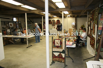The basement floor of the Jefferson Townhouse has been restored, where some artists set up their displays for the fundraiser on Saturday. (J Maguire photo)