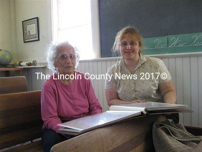 Mary French, of Windsor (left), and her granddaughter Elizabeth Chamberlain, of Palermo, visited the Center Schoolhouse in Alna on July 11 to strengthen old ties with friends and family.