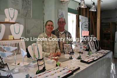 """Cynthia Bragg (""""Bragging About Beads"""") proudly displayed her handmade jewelry at the Jefferson Townhouse art show on Saturday, joining many other artists to raise funds for the Townhouse restoration project. Bragg is joined by her assistant, Gregory Hodge. (J Maguire photo)"""