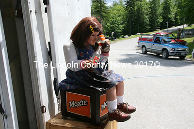Moxie girl, an automated doll pours herself a glass of the cool beverage in the shade. She was one display among others at Moody's Gifts (next to Moody's Diner) on Rt. 1 in Waldoboro in celebration of Moxie Day on June 9. (J Maguire photo)