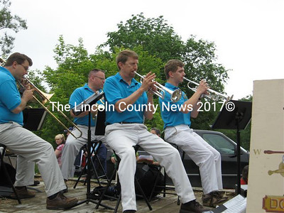 Dwight Tibbetts, of Windsor, with the Downeast Brass Band, performs in the Whitefield 4th of July parade. At right is Tibbetts' son, Ben.