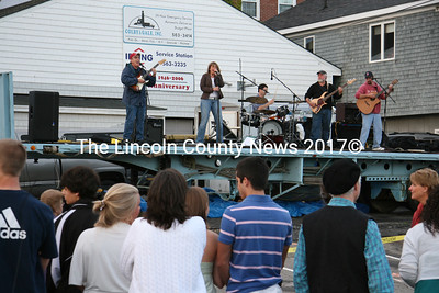 The School Street Band rocked the crowds as the clouds broke over the back parking lot in Damariscotta on July 4. (J Maguire photo)