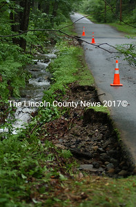 Heavy rains caused the Senot Road shoulder in Jefferson to wash out. The fire department was called out to a nearby home on Enos Road to pump out flood waters.