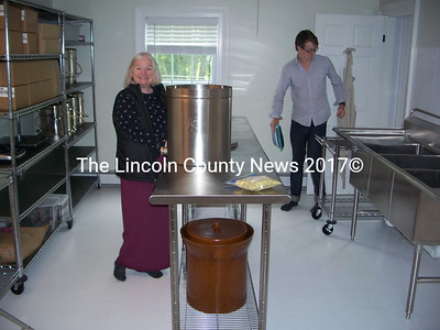 Manufacture of ElderTide Pharms nutraceutical products will go on in areas like this, which Edie Johnston, left  shows with business partner and son George in the background. (Greg Foster photo)