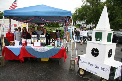 A Save the Steeple committee joined the crowds in the back parking lot in Damariscotta on July 4th. Pictured here are Greta Bickford, Cindy Vaughn, Taylor Vaughn, Brenda Goth, Faye Cain, Debby Tibbetts, Joanne Jacobs, Winton Jacobs and John Keyser. (J Maguire photo)