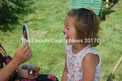 Haley Allen laughed with surprise when she saw her new wildcat face painted on Jefferson Day. (J Maguire photo)