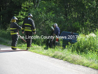 Newcastle firefighters kept the brush from burning underneath this Ford pickup that slipped off the road Friday afternoon. Emergency medical service personnel took the driver to Miles Memorial Hospital, as he was suffering from symptoms related to a medical condition. (J Maguire photo)