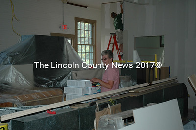 """Clerk Lorraine Rice is on a""""treasure hunt"""" for a document in the Bristol Town office as workers make extensive repairs to the 200 year old structure. She found it. (Joe Gelarden photo)"""