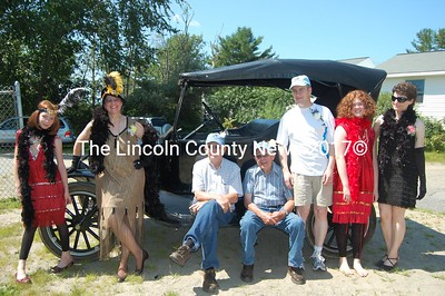 The Bragg family gathered to celebrate Norman Bragg's completing the restoration of his 1923 Model T Ford. Bragg (seated-right) is joined by fellow restorer George Sproul, who helped get the car back to shape, fitting the older model vehicle with upholstery and new wood floorboards. The Bragg family celebrates Norman's 80th birthday in conjunction with the many years' dream of getting the car back on the road. (J Maguire photo)