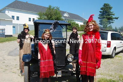 The Bragg Family Flappers posed in 1920s garb in front of Jefferson resident Norman Bragg's 1923 Model T Ford. The family gathered to celebrate a momentous occasion marking the completion of Bragg's restoration of the vehicle. They rode in the car, in line with many other older vehicles, in the annual Jefferson Day celebration on Saturday. (J Maguire photo)