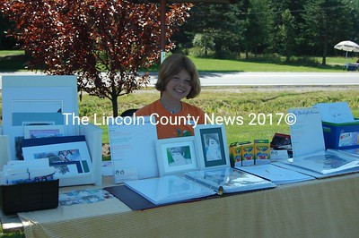 Rising Manga artist, Holly Starlight, proudly displays her work at the annual Jefferson Day celebration. (J Maguire photo)