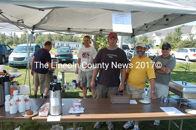 Masonic Lodge Square and Compass members served fresh doughnuts and hot coffee Saturday morning, kicking off activities on Jefferson Day. Steve Flagg (red hat) is the Worshipful Master, joined by past Master Bill Mitchell (yellow t-shirt), past Master Dan Mellor (right), brothers Shawn St. Cyr and John Burbank (left). (J Maguire photo)