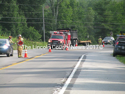 A man on a motorcycle reportedly sustained minor injuries in a collision with a box truck on Rt. 1 in Nobleboro Monday morning. First responders cleared the scene in about an hour.(J Maguire photo)
