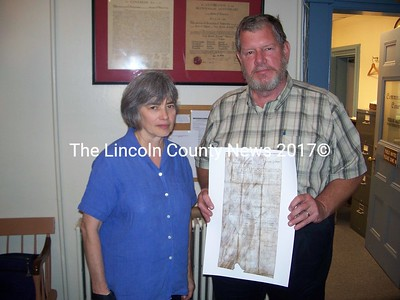 Lincoln County Historical Association director Jay Robbins and Mary Ellen Barnes show a copy of the 1760 incorporation document for Pownalborough as they head up preparations for the 250th anniversary celebrations next year in Lincoln County. (Greg Foster photo)
