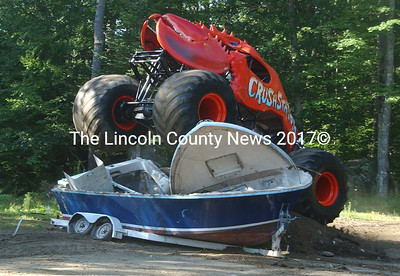 Monster Truck Crushstration is designed to crush vehicles. Owner Greg Winchenbach is shown here testing her out for the first time by crushing a boat. (Paula Roberts photo)