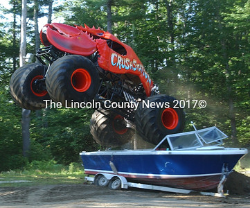 Crushstration jumps a boat on her maiden test flight on July 31. Owner Greg Winchenbach of Jefferson is preparing her for Monster Truck competition. Crushstration still needs a little tweeking before she is ready for the national circuit. (Paula Roberts photo)
