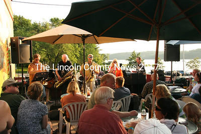 Bonnie Edwards and the Practical Cats packed the porch at the Mediteranean Kitchen in Damariscotta on Saturday. (J Maguire photo)
