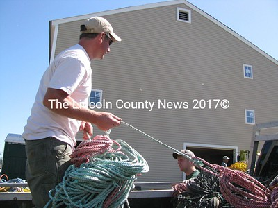 Mike Cushman hauls his lobster traps out of Port Clyde. He went to drop off his float rope, which Waldoboro entrepreneur Penny Johnston will use to weave doormats. (J Maguire photo)