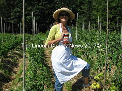 Suzanne Goldenson will have to see what the harvest will bring from her some 200 hierloom tomato plants on her saltwater farm in Bremen. This is Goldenson's second year in production for the Heirloom Tomato Sauce Co., making her own Marinara Mother Sauce. (J Maguire photo)
