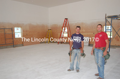 Construction superintendent Michael Catalano, right, of Catalano's Construction, Inc. of Thomaston, and summer employee Mike Ianello pause for a breather while working on the inside of the Alna firehouse addition. (Greg Foster photo)