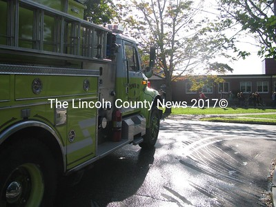 "A crowd of students at Lincoln Academy in Newcastle made their way back into the school building after a false alarm in their first full week of classes on Sept. 1. According to L.A. principal Jay Pinkerton, a spike in water pressure caused the school sprinkler system to go off. He said a water company crew up the hill from the school on Academy Hill Road were doing some water work at the time, indicating that their work might have had something to do with the spike. He couldn't say for sure. ""I'm just glad it's nothing,"" Pinkerton said. (J Maguire photo)"