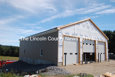 The large three-bay Alna firehouse addition facing Rt. 218 will house all of the fire department's trucks after completion this month. (Greg Foster photo)