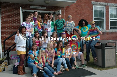 """Peace, Love and very cool. Flanked by Kevin Dowling, in large black wig, a school social worker, Lincoln Academy students dressed up for """"Woodstock Day"""" last week.  (Joe Gelarden photo)"""