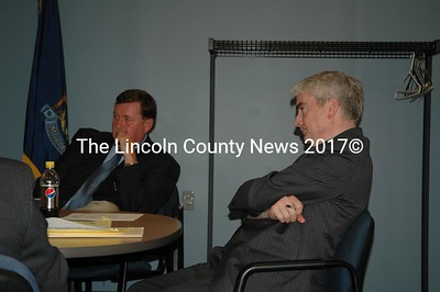 State Corrections Board chairman Neale Duffett (right)  listens as Twin Bridges Jail officials explain fincal woes. Jail Administrator Mark Westrum listens. (Joe Gelarden photo)