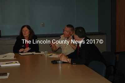 Lincoln County Sheriff Todd Brackett (center) argues costs while Sagadahoc Sheriff Joel Merry (right) and state corrections official Denise Lord listen. (Joe Gelarden photo )