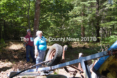 Cleanup of the former Glen Lewis property on Foye Road progresses. From left, Tina MacDonald and Marla Blagden pick up junk on Friday at the site. (Greg Foster photo)