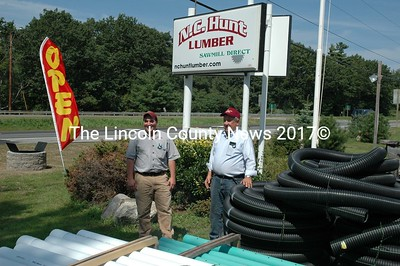 Robbie (left) Hunt and his dad, Norman at their new building supply operation on the northend of Damariscotta. The Hunts plan a major lumber and building supply on Rt. I. (Joe Gelarden photo))