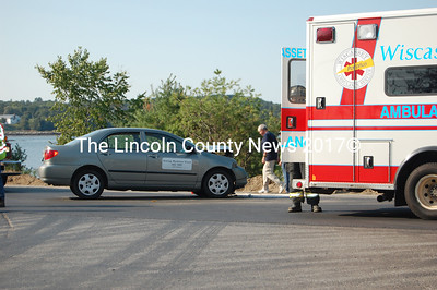 One of two persons injured in one of the two cars involved in a two-car crash last Thursday around 4 p.m. in Edgecomb went to Miles Memorial Hospital via Wiscasset Ambulance Service. (Greg Foster photo)