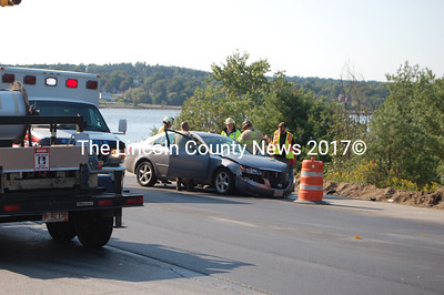 Firefighters and EMT's prepare to remove one of the injured persons in a two-car crash at the intersection of Eddy Road and Rt. 1 in Edgecomb at 4 p.m. last Thursday. It was second accident in the same area within a few hours. (Greg Foster photo)