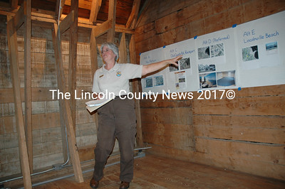 Beth Goettel, the refuge manaer for the Maine Coastal Islands National Wildlife Refuge explains the process her agency is using to locate a headquarters and coastal education center. The presentation took place at Darrow's Barn in Damariscotta. (Joe Gelarden photo)