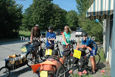 The O'Donnells of Southwest Harbor stopped in Wiscasset for lunch Wednesday as they neared the end of their cross-country bike ride. From left they are Mike, the dad, Rebecca, the sister, Deb, the mother and James the brother. (Joe Gelarden photo)