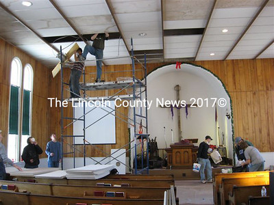 Volunteer church workers begin inside repairs at the former Whitefield Union Church on Saturday. (Lucy L. Martin photo)
