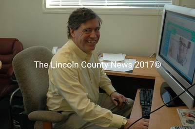 """Dr. """"Chip"""" Teel at his work station where he can check on his patients via computer camera. (Joe Gelarden photo)"""