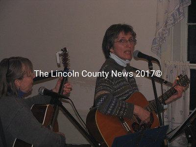"""Whitefield residents Lucy Martin (right) and Judy Ekholm entertained the growing crowd at the Kings Mills Union Hall with folk ballads and other songs such as """"Keep On the Sunny Side of Life"""". They joined many fellow residents at the Jan. 9 benefit supper to support Stephen and Holly Torsey who lost their Townhouse Rd. home to fire recently. Martin said the event raised more than $1000 for the couple. (J Maguire photo)"""