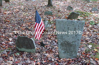 The headstones for Patience (Winslow) Hodgkins (left) and her son Thomas. The U.S. flag honors the service of Patience's husband David. The hand-wrought inscription on Thomas' stone is easily read.