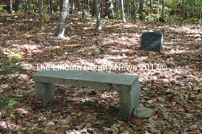 This granite bench offers a place for contemplation and rest. It is placed near the headstone of the Schaff twins.