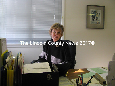 Betty Kennedy, secretary at Wiscasset Police, is already busy at work in the department's new temporary location. Despite the grand new view, she said she finds it a little quiet compared to the busy Rt. 1 location. (J Maguire photo)
